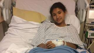 Arya Lloyd in a hospital bed