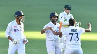 Rishabh Pant (C) of India celebrates with team mates Navdeep Saini (L) and Mohammed Siraj (R) after winning on day five of the fourth Test Match between Australia and India at the Gabba in Brisbane, Australia, 19 January 2021.