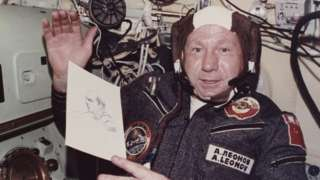 Alexei Leonov holds a sketch he drew during the joint US-USSR Apollo-Soyuz mission in 1975