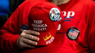 A supporter holds his hat to his chest during the national anthem before a campaign rally for President Donald Trump on January 9 in Ohio
