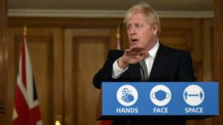 Britain's Prime Minister Boris Johnson speaks during a press conference in 10 Downing Street on October 31, 2020 in London, England.