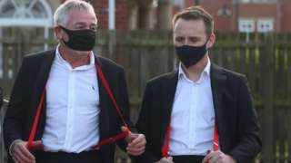 Mourners wear red braces in memory of Bobby Ball