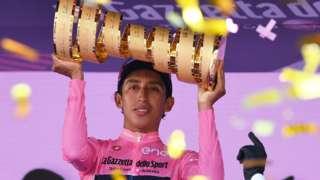 Egan Bernal holds up the trophy for winning the 2021 Giro d'Italia