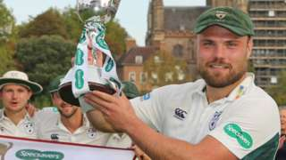 Worcestershire captain Joe Leach lifts the Division Two title