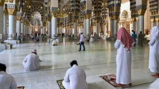 Worshippers pray in the Prophet's Mosque in Medina after it reopened for worshippers in late May