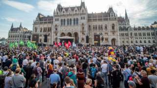 Demonstrators gather in front of the parliament in Budapest, Hungary, 5 June 2021