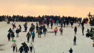 Crowds sledging on Cow Hill on Newcastle Town Moor