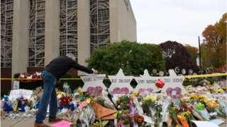 Man visits memorial outside Tree of Life synagogue