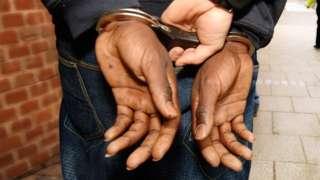 Handcuffed offender