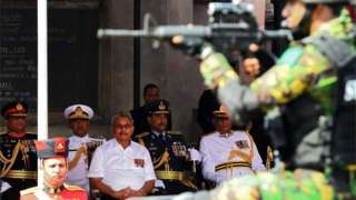 """Sri Lanka""""s President Gotabaya Rajapaksa (C) looks on as military personnel parade during Sri Lanka""""s 72nd Independence Day celebrations in Colombo on February 4, 2020."""