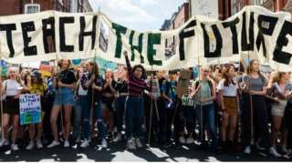 Teach the Future banner at climate demo