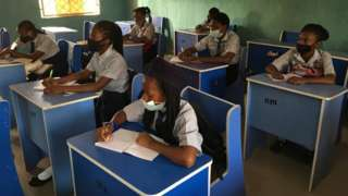 Students in Abuja sit in classroom as schools resume