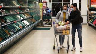 Shoppers are seen inside a Tesco store wearing face masks while shopping in a supermarket on March 18, 2020 in Southampton, United Kingdom.