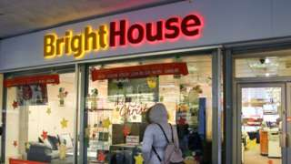Shopper walks past BrightHouse