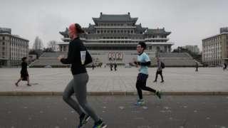 Runners in Pyongyang's annual marathon