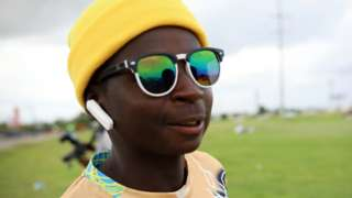 A man with a yellow head warmer