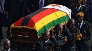 Robert Mugabe's coffin is carried to a military helicopter after lying in state - 13 September