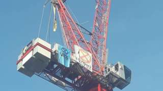 A youth protestor has scaled a crane in Norwich