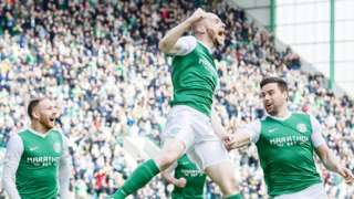 Hibs skipper David Gray celebrates making it 3-0 to Hibernian