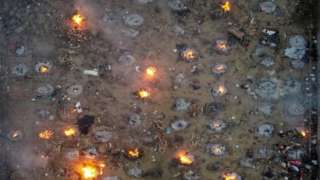 A mass cremation of victims who died due to the coronavirus disease (COVID-19), is seen at a crematorium ground in New Delhi, India, April 22, 2021.
