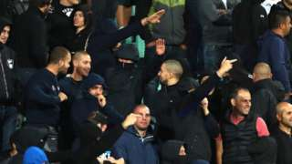 Bulgarian fans give Nazi salutes during the match against England