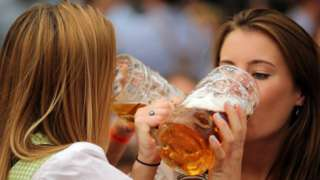 Young women enjoy drinking beer out of 1-liter-mugs of beer during the opening weekend of the 2019 Oktoberfest