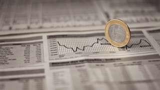 gráfico e moeda do real