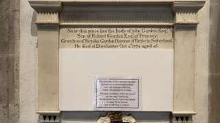 Covered memorial stone to John Gordon in St Peter's in Dorchester
