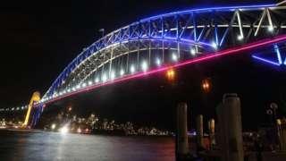 Sydney Harbour Bridge illuminated with coloured lights