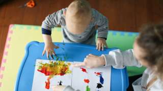 Childminders and child - stock pic