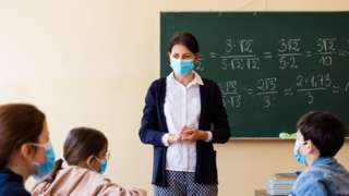 teacher class in mask