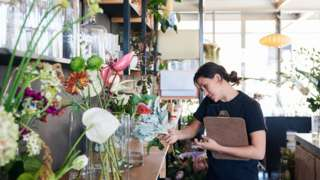 A woman working in a flourist