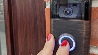finger pushing doorbell