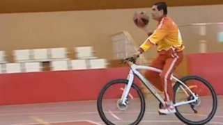 Kurbanguly Berdymukhamedov playing basketball on a bicycle