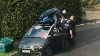 Police help Isa out of roofbox