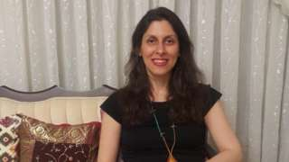 Hfile photo dated 17/03/2020 of Nazanin Zaghari-Ratcliffe, a British-Iranian dual national who is detained in Iran sitting on a sofa in front of a background of curtains