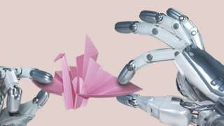 Two robot hands gently manipulate an origami paper crane