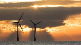 Offshore turbines in Norfolk at sunrise