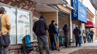 Customers queue outside a LA county gun shop