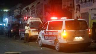 Ambulances are seen near the scene of a car bomb explosion