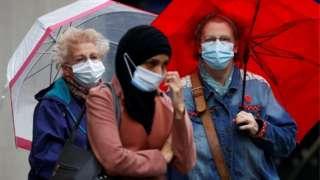 Woman in masks in Blackburn