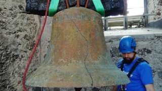 Bell being removed