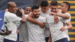 Manchester City celebrate scoring at Crystal Palace