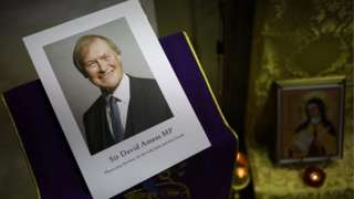 An image of Sir David Amess, displayed at the mass said for him on the day of his death