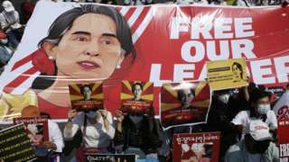 Demonstrators hold placards and banners calling for the release of detained Myanmar State Counselor Aung San Suu Kyi