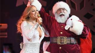 Maria Carey and Father Christmas