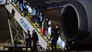 Australian Open players disembark a flight