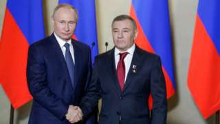 Russia's President Vladimir Putin (L) awards a Russian Hero of Labour gold star to Stroygazmontazh owner Arkady Rotenberg