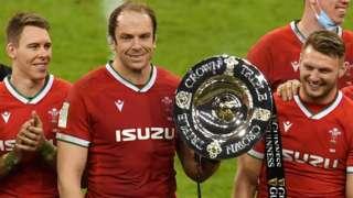 Liam Williams, Alun Wyn Jones and Dan Biggar celebrate Wales' Triple Crown