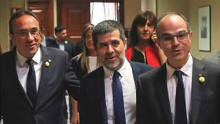 Jailed Catalan politicians (L-R) Josep Rull, Jordi Sanchez and Jordi Turull registered on 20 May as MPs